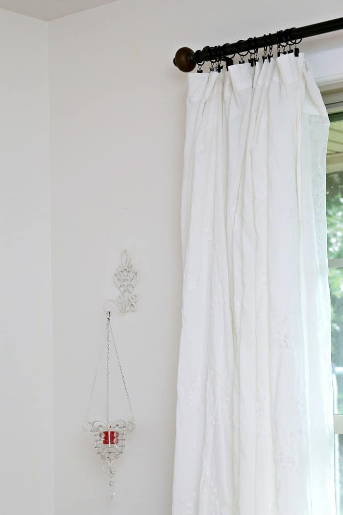 white curtains in the guest bedroom