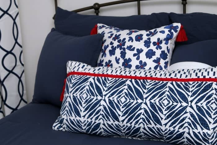 Blue and white pillows from Target have red tassels