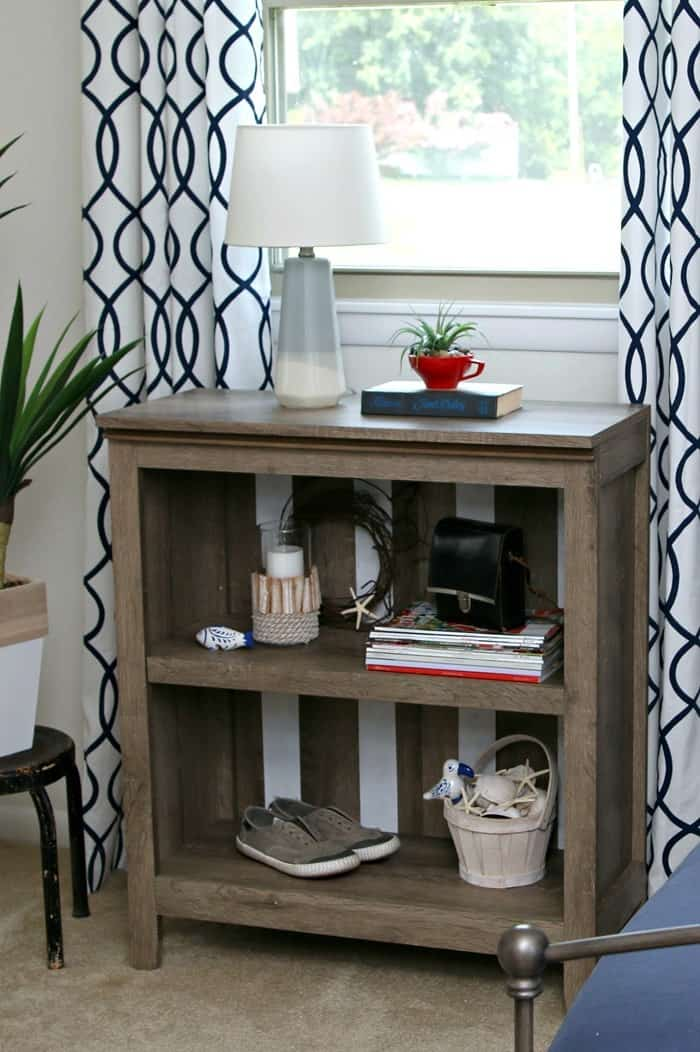 Target bookcase rustic finish custom painted with white stipes using Delta Ceramcoat paint