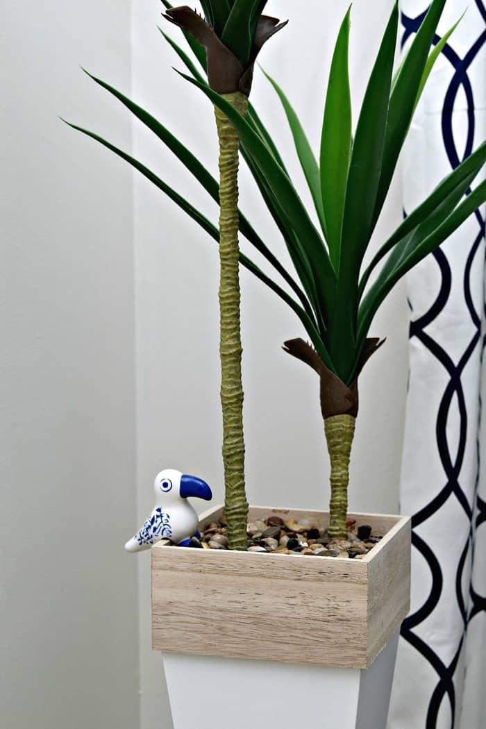 Tucan bird plant sitter