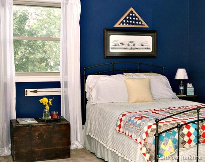 blue bedroom with antique wood trunk nightstand