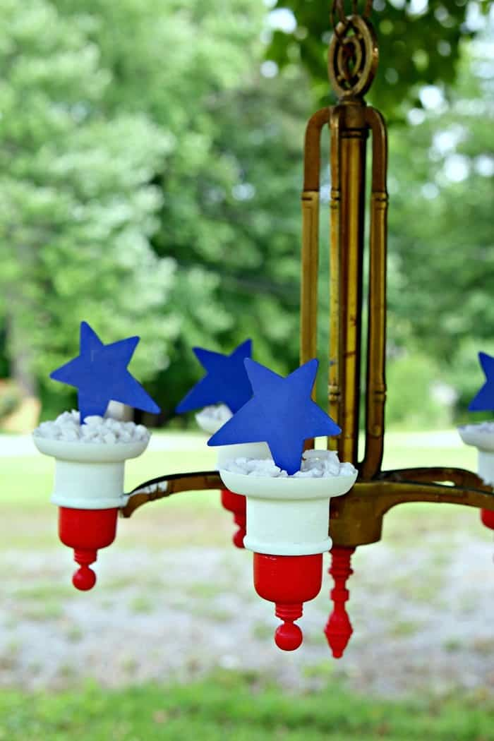 blue stars and red and white striped brass chandelier makeover