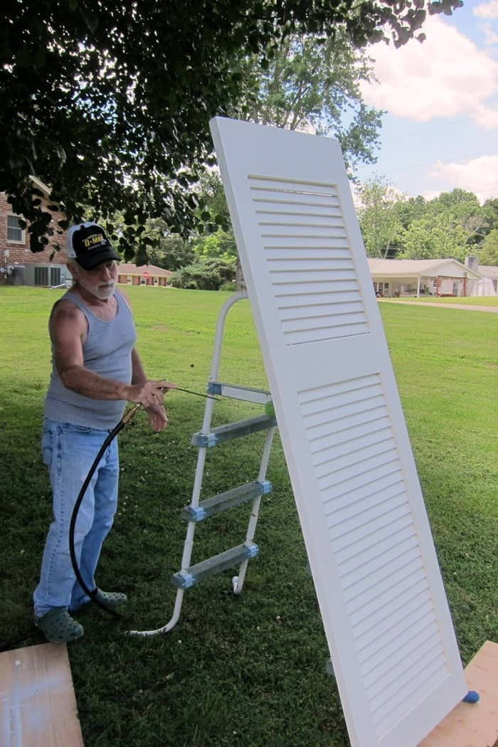 clean doors with an air hose or cleaning solutions before painting