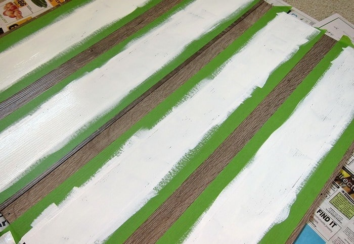 how to paint white stripes on a bookcase using FrogTape and white paint