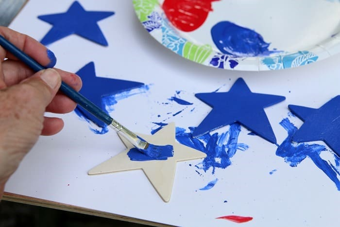 painting blue stars for red white and blue diy project
