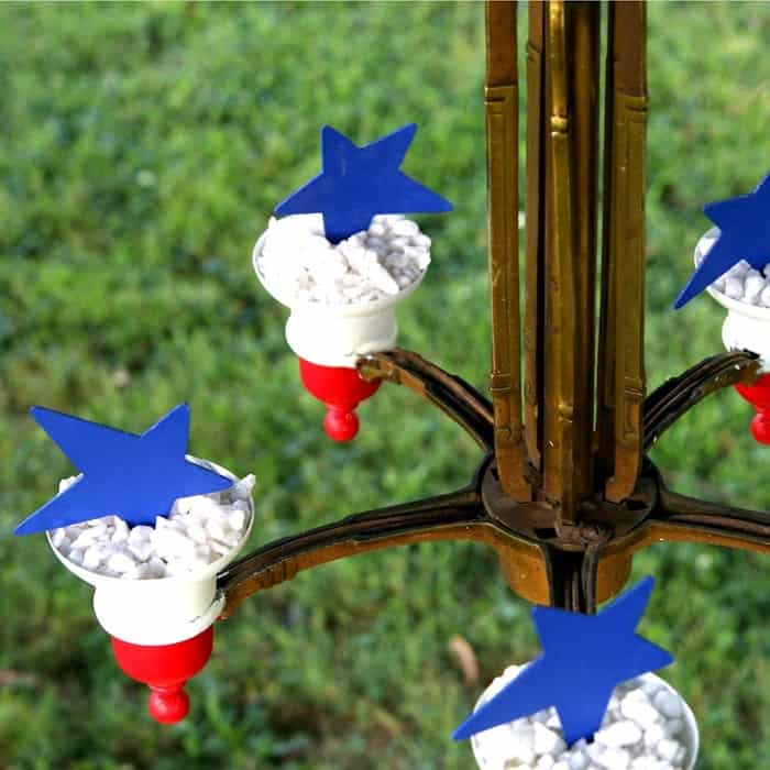 red white and blue project made from an upcycled brass chandelier