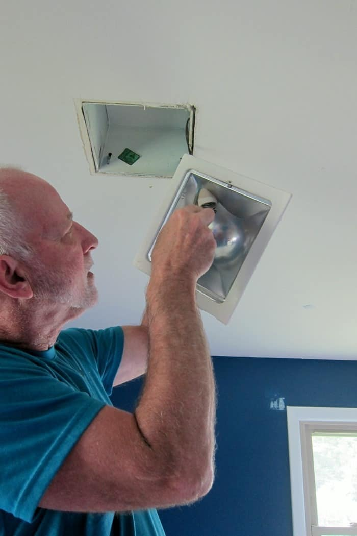 removing a ceiling light fixture to install a ceiling fan