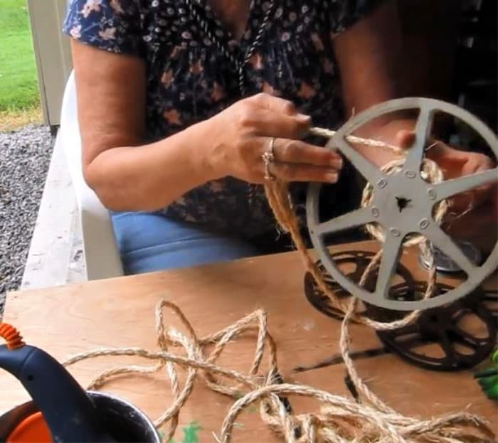 spooling the sisal rope onto the movie reel