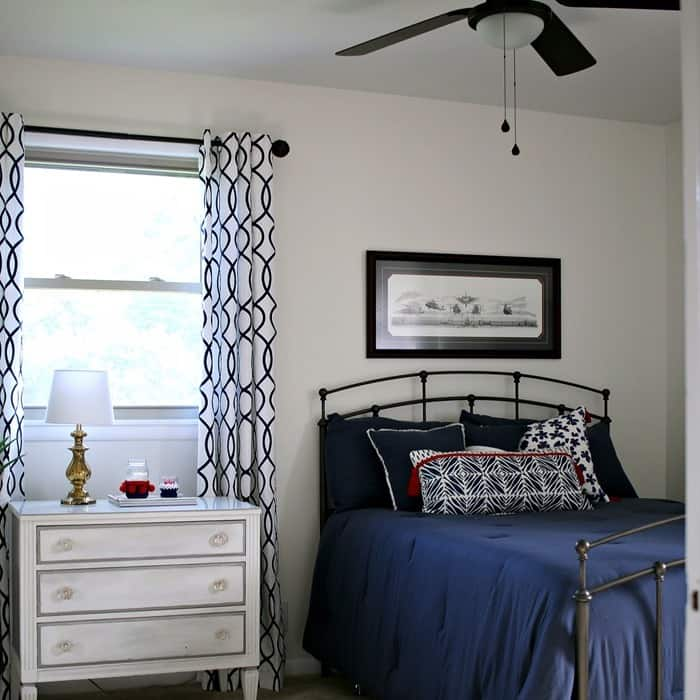 total bedroom transformation with paint, ceiling fans, furniture, bedding and more in navy and whtite with pops of red