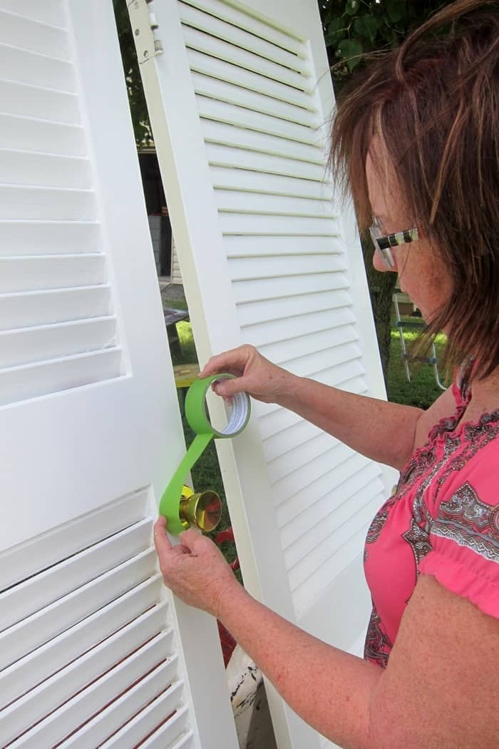 use FrogTape on door knobs to protect from paint spray