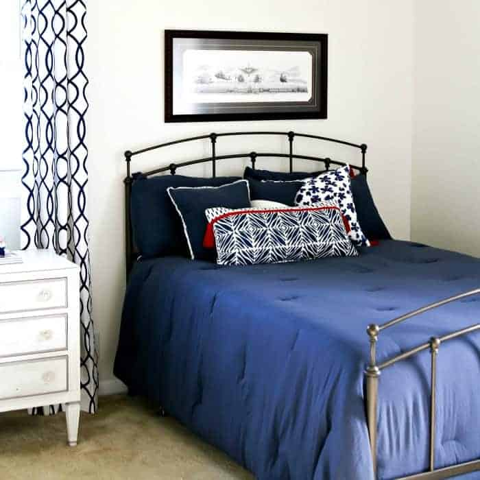 white bedroom walls and navy bedding for bedroom makeover 1