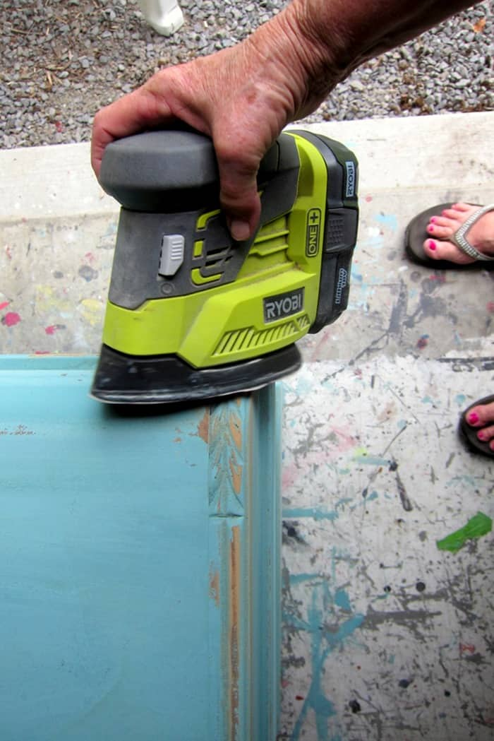 distressing painted furniture with a battery powered sander