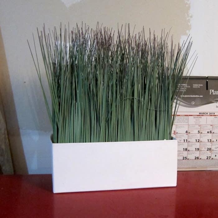 faux grass in a plain white box