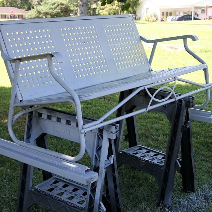 metal furniture painted with primer using a paint sprayer