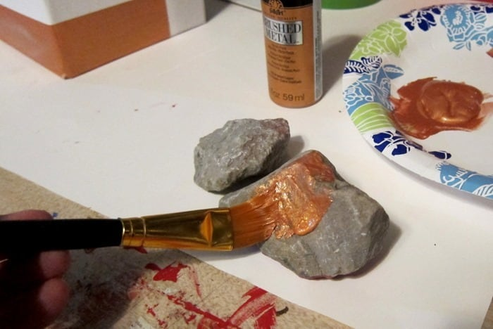 painting a rock with metallic copper paint
