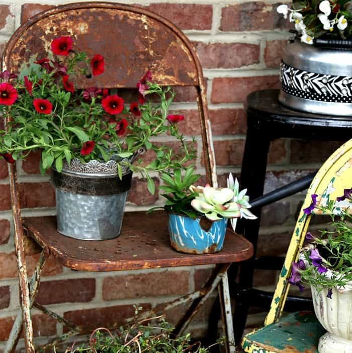 vintage tea kettles and water dippers make great flower pots
