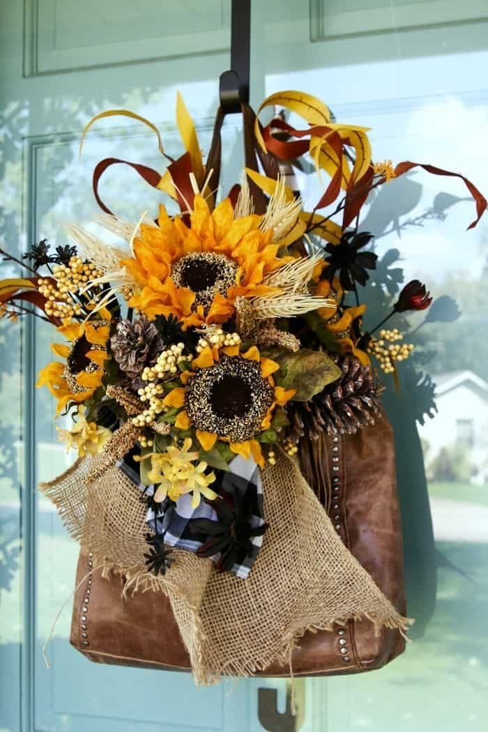 Make a purse wreath for your front door using sunflowers and buffalo check fabric