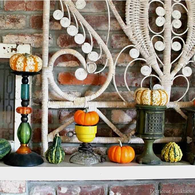colorful pumpkins and thrifty vintage finds make fun mantel decorations