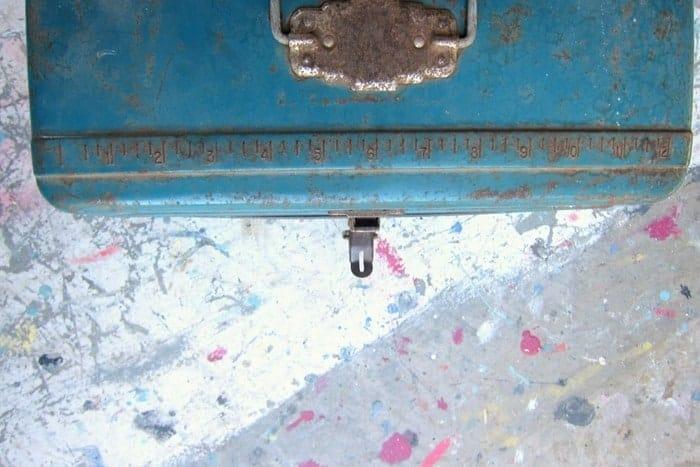 ruler on metal tackle box