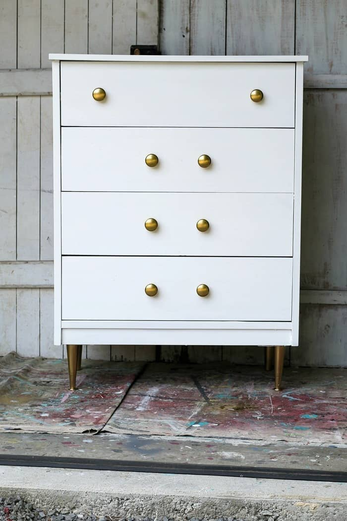 white furniture with gold knobs