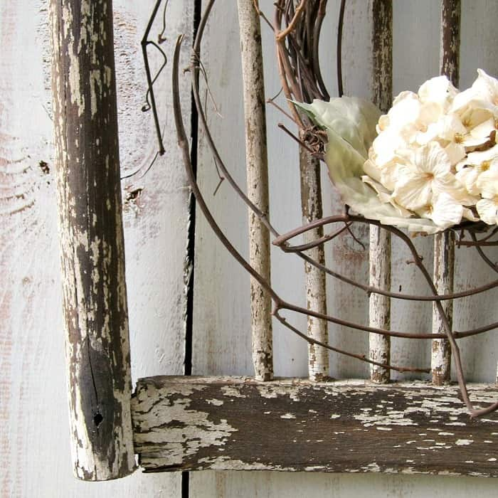 Old shabby wood chair back makes a great backdrop for a wreath