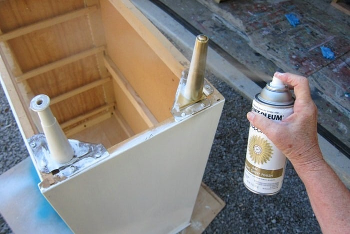 Spray paint furniture legs metallic gold and paint the furniture white for a nice contrast