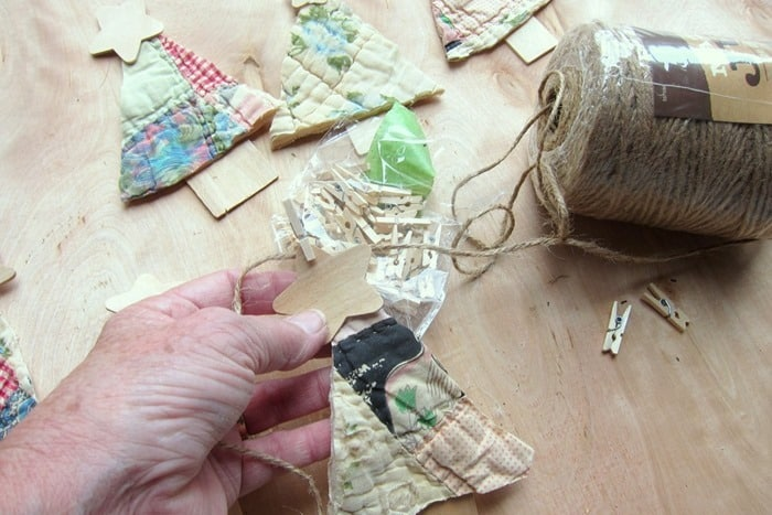 attach diy trees to twine using mini clothes piins