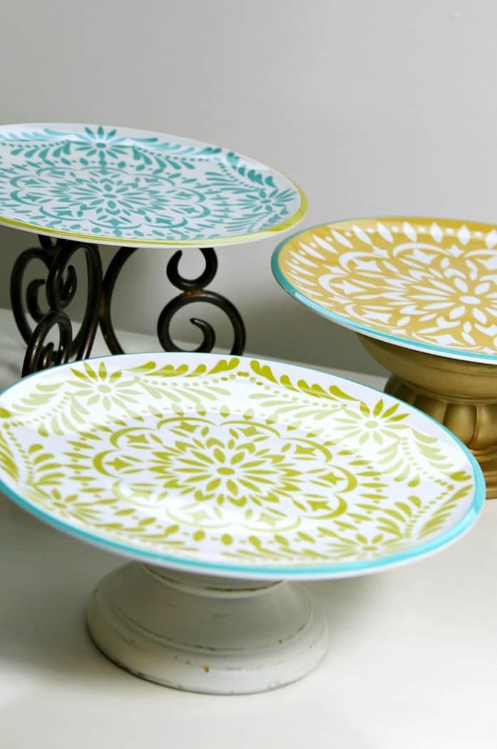 make serving stands using candle holders and dinner plates