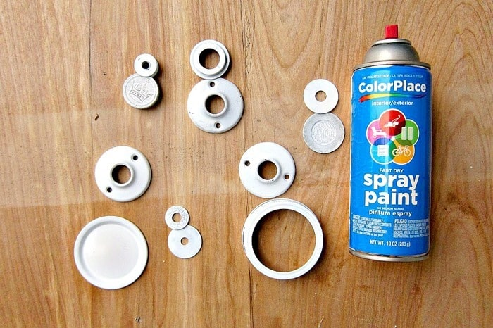 use inexpensive white spray paint to make snowman ornaments