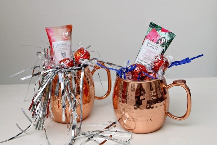 Copper mugs filled with gifts