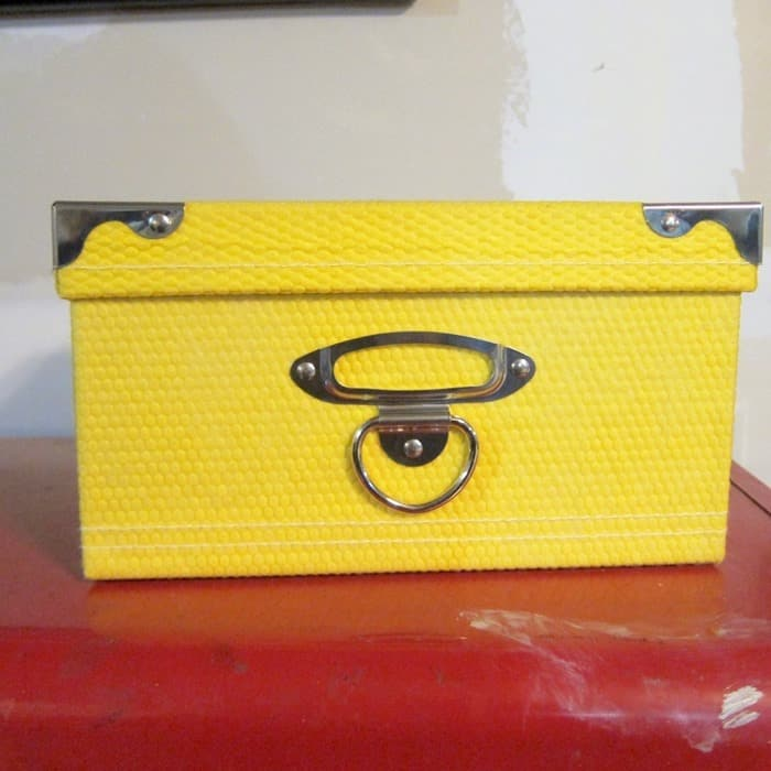 yellow box with metal corner details from Goodwill