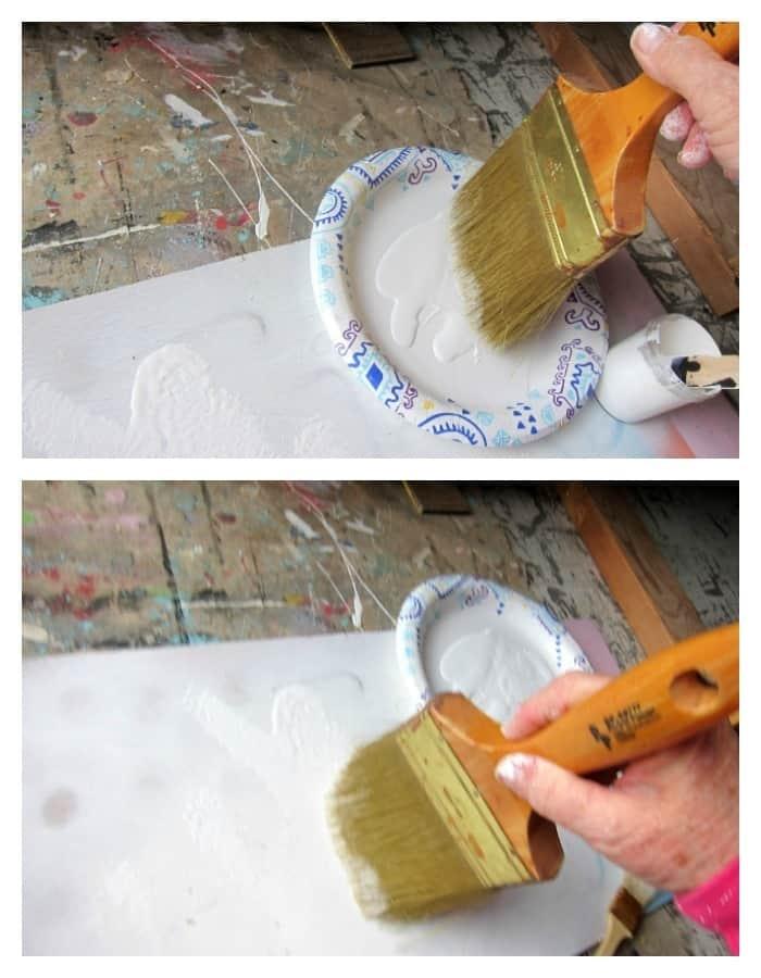 dry brushing white paint over gray