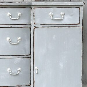 weathered gray sideboard with distressed paint