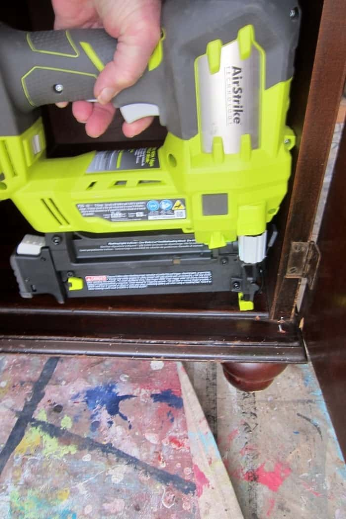 making furniture repairs using a Ryobi brad nailer