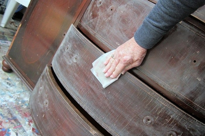 sanding furniture by hand
