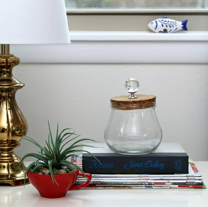 add a drawer pull to a glass jar top and make a candy jar