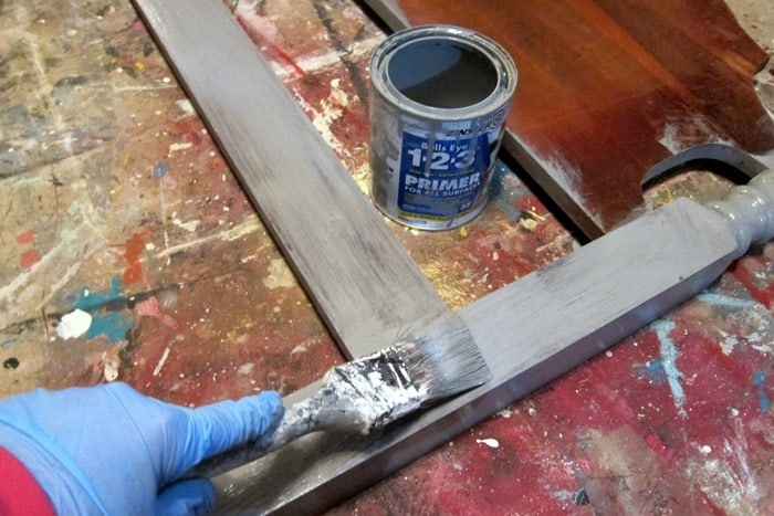 apply gray primer to furniture before painting