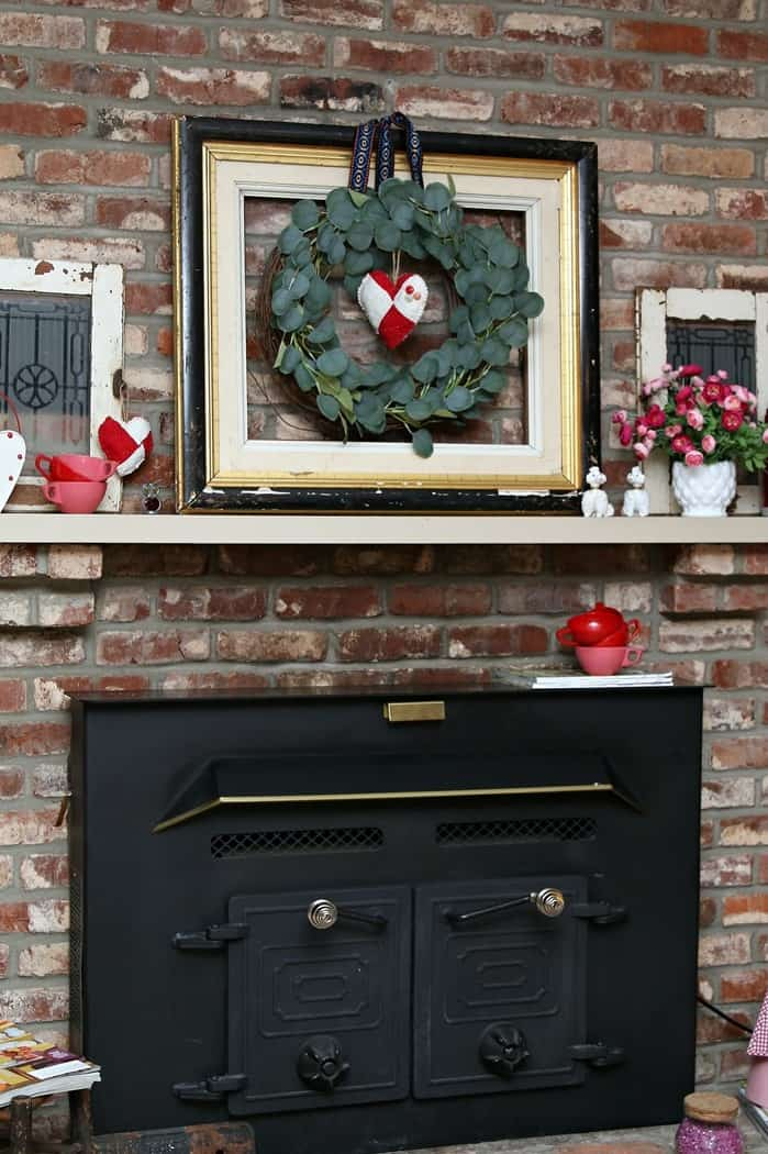 how to decorate a fireplace mantel with thrift store and flea market finds