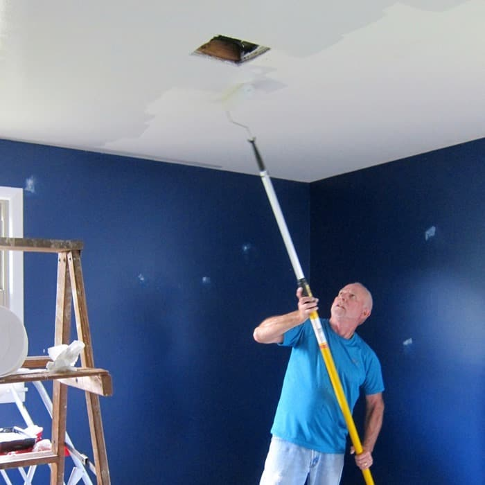 painting bedroom ceiling with paint stick