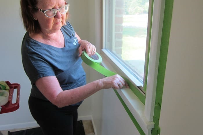 tape around windows with painters tape before painting