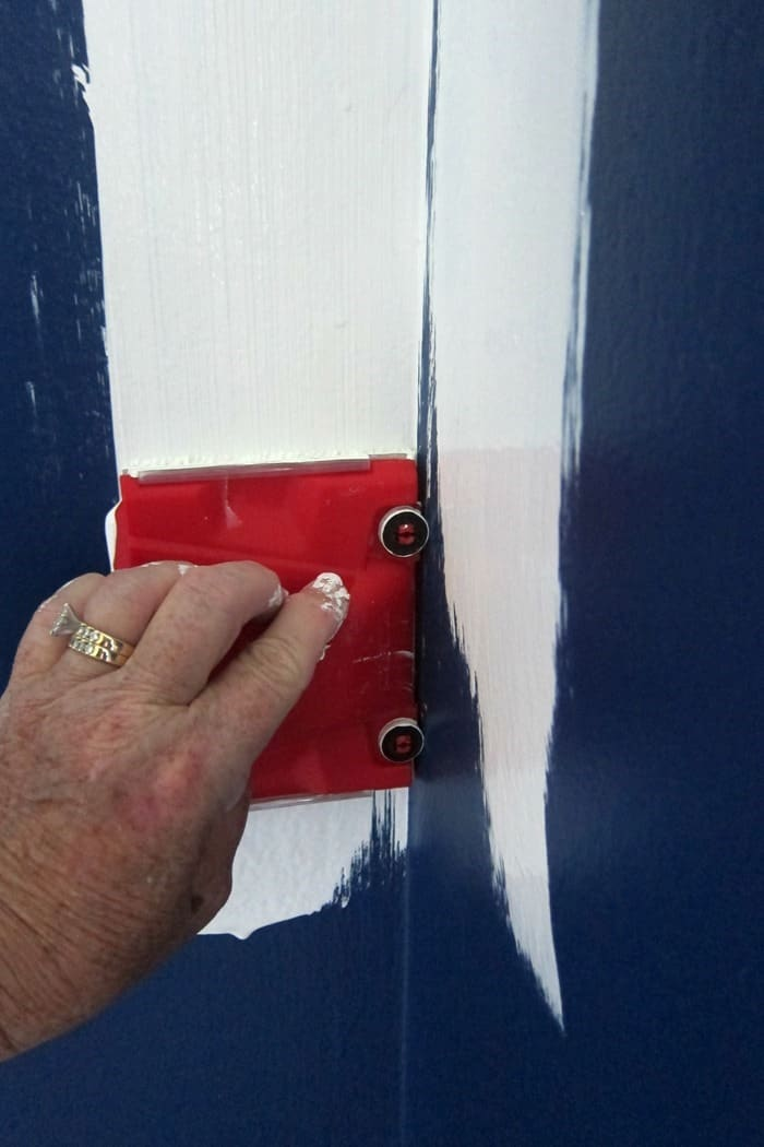 using a paint trim tool in corners