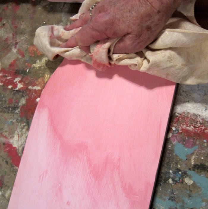 wiping excess paint with a rag