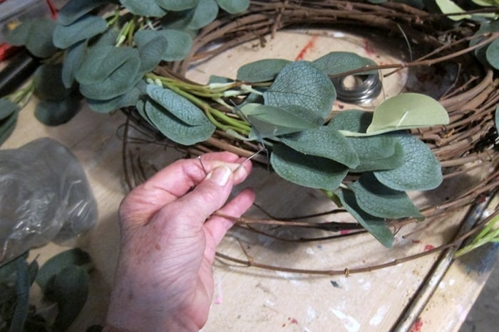 wire a eucalyptus vine to a grapevine wreath