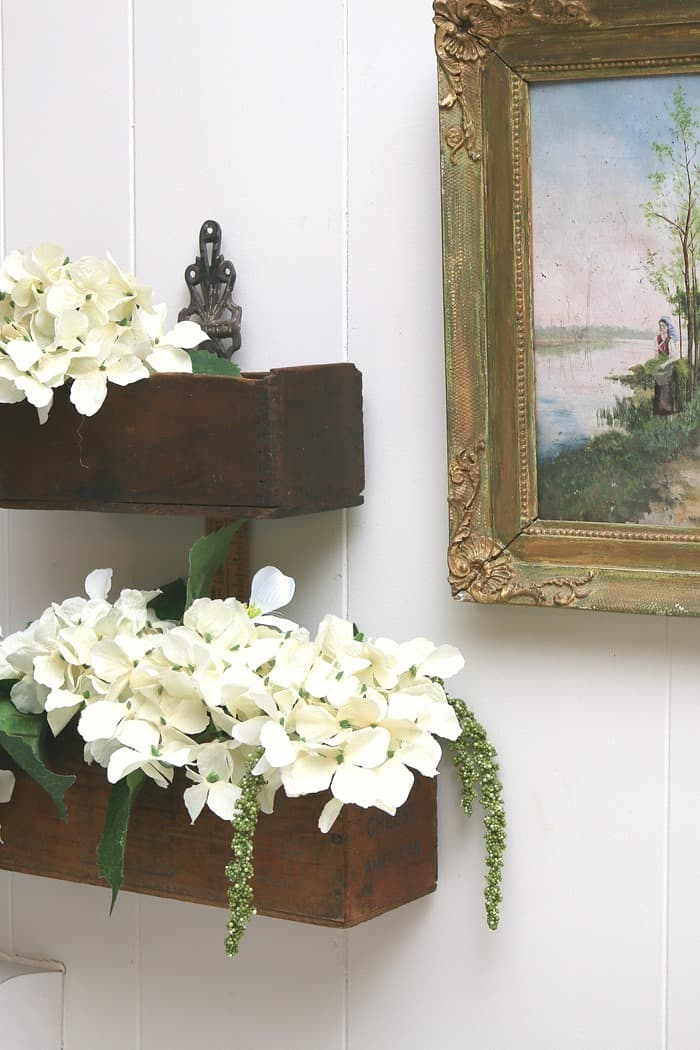 flower display in an recycled upcycled cheese box