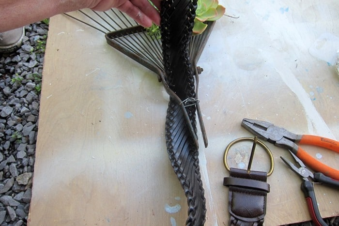 pull the belt through the top of the rake to make a hanger