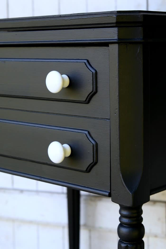 Remove the machine from the sewing machine cabinet and paint the cabinet to use as an end table