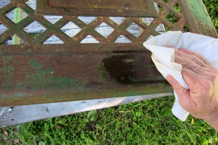apply wax to vintage metal furniture to save rusty patina