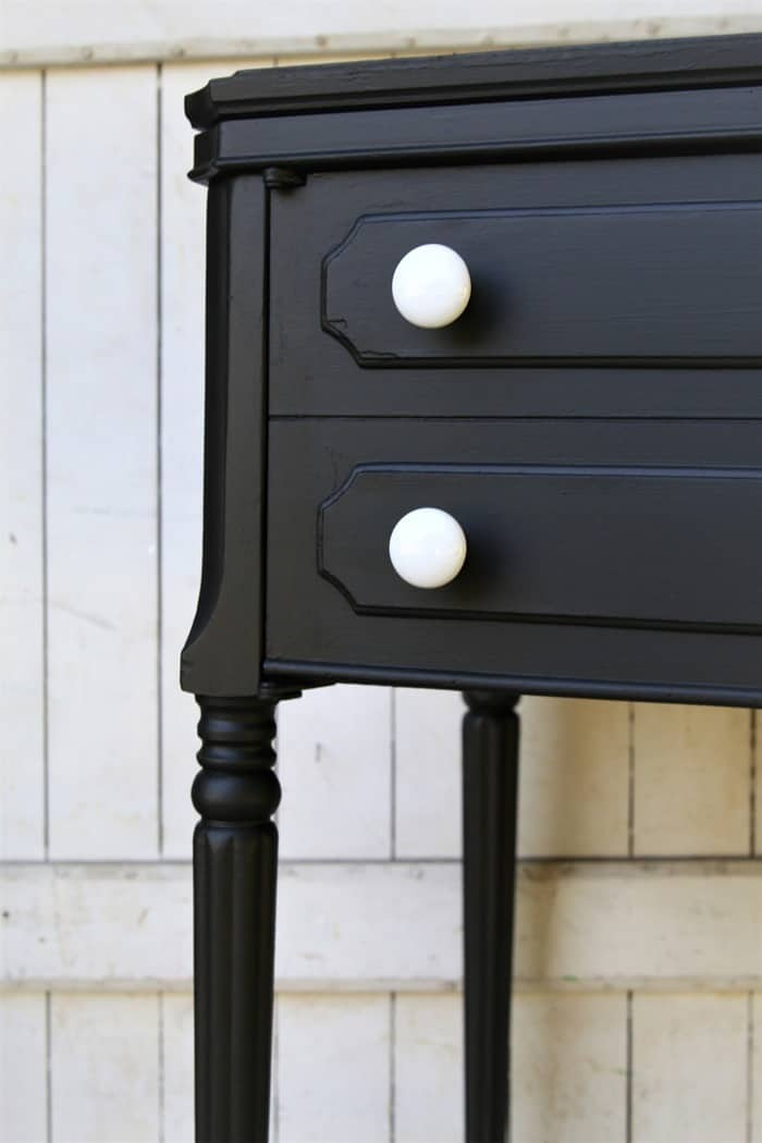 black furniture with white knobs