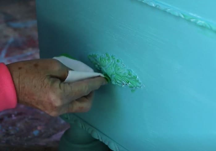 green color wash on turquoise paint