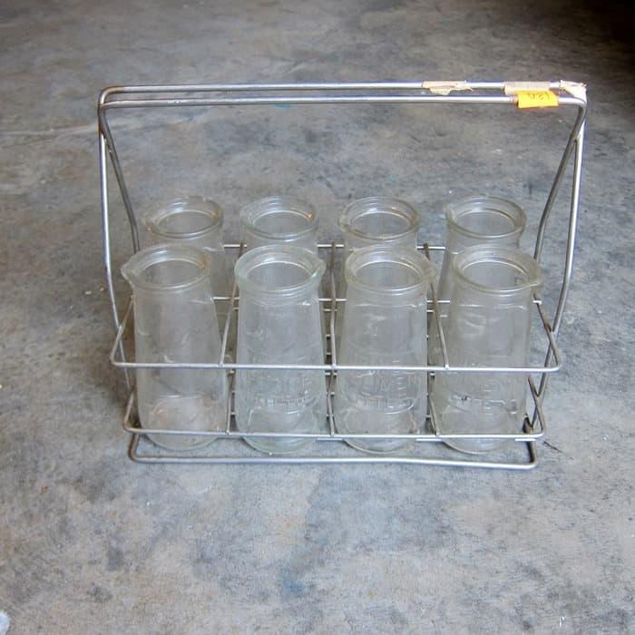 Vintage urine specimen bottles in metal carrier